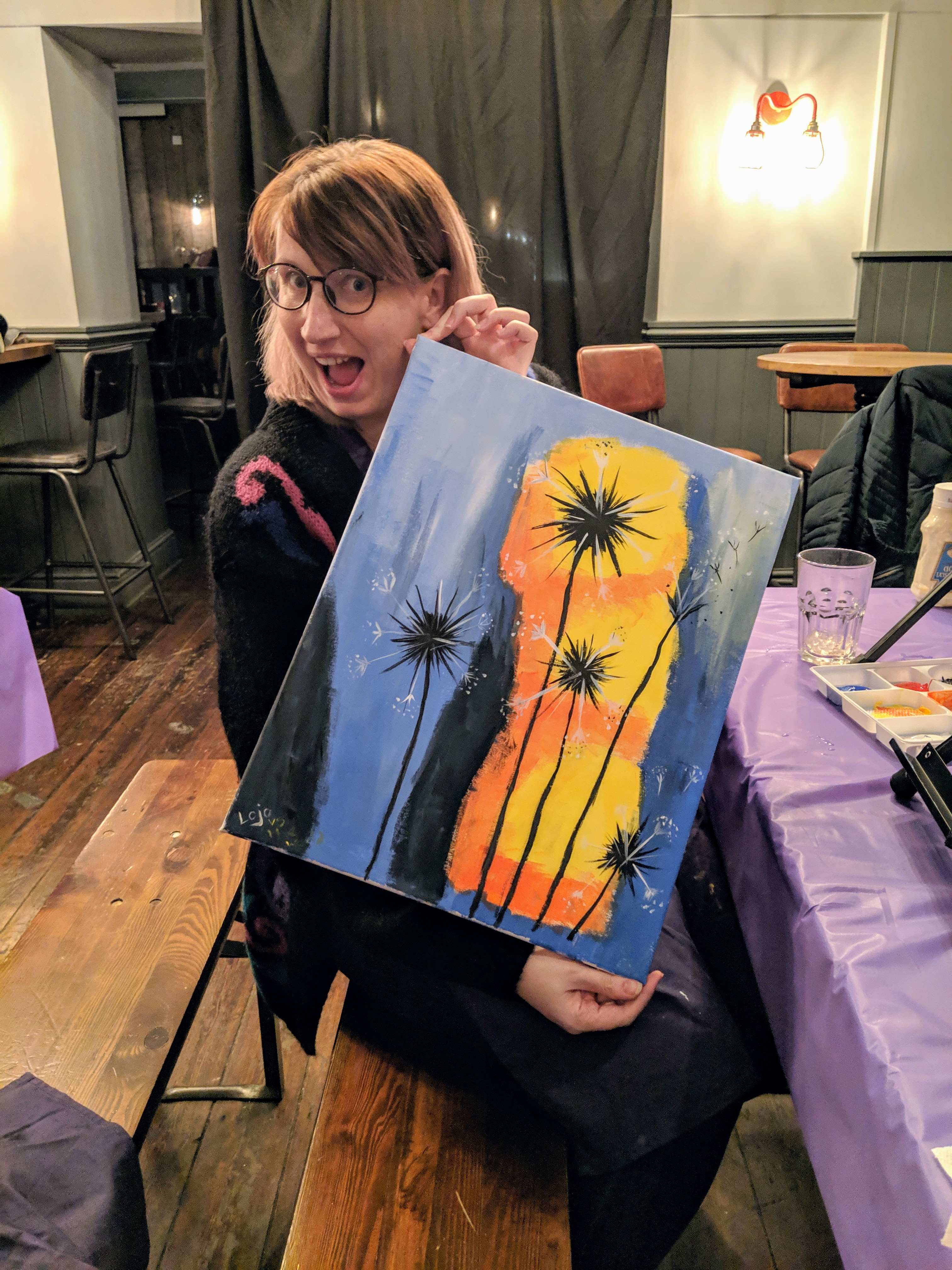 Holding my painting at the paint republic