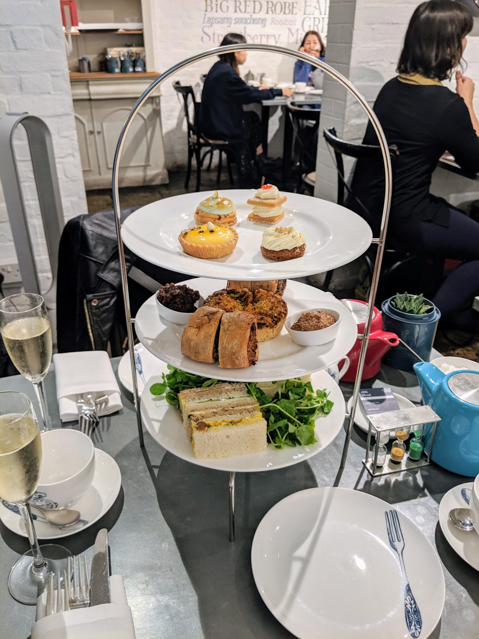 afternoon tea tower tray full of sandwiches, savouries and cakes